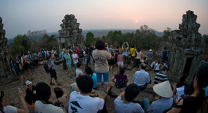 Tourists watch the sunset from Phnom Bakheng in the city of Angkor Thom, Cambodia.