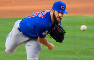 Chicago Cubs starting pitcher Jake Arrieta throws to the plate during the second inning of a baseball game against the Los Angeles Dodgers, Sunday, Aug. 30, 2015, in Los Angeles.