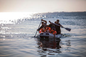 File: A Syrian family arrive in an inflatable dinghy at Kos ferry port after the crossing from Turkey on August 30, 2015 in Kos, Greece.