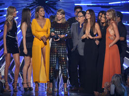 "Taylor Swift, center, accepts the award for video of the year for ""Bad Blood"" at the MTV Video Music Awards at the Microsoft Theater on Sunday, Aug. 30, 2015, in Los Angeles. Pictured from left are, Martha Hunt, Hailee Steinfeld, Gigi Hadid, Joseph Kahn, Lily Aldridge, Mariska Hargitay and Karlie Kloss. (Photo by Matt Sayles/Invision/AP)"
