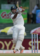 File: India's Cheteshwar Pujara plays a shot on the third day of their third test cricket match against Sri Lanka in Colombo, Sri Lanka, Sunday, Aug. 30, 2015.