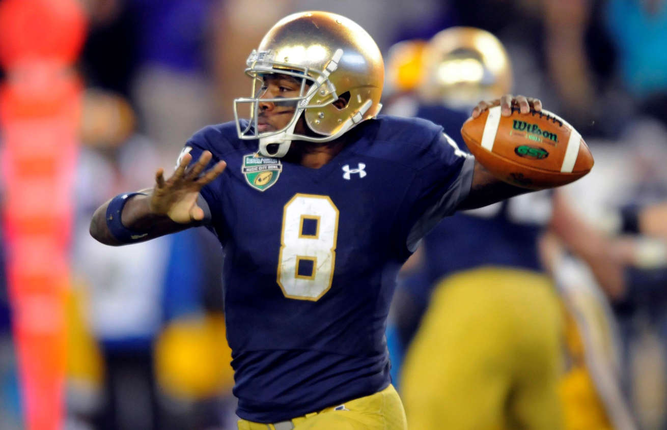 Dec 30, 2014; Nashville, TN, USA; Notre Dame Fighting Irish quarterback Malik Zaire (8) passes during the second half against the LSU Tigers in the Music City Bowl at LP Field. Notre Dame won 31-28.
