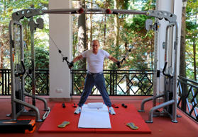 Russian President Vladimir Putin exercises during his meeting with Prime Minister Dmitry Medvedev, unseen, at the Black Sea resort of Sochi, Russia, Sunday, Aug. 30, 2015. (AP Photo/RIA Novosti, Mikhail Klimentyev, Presidential Press Service)