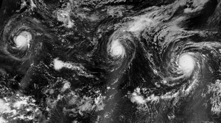 A nighttime view of hurricanes Kilo, Ignacio, and Jimena (from west to east). The image is a mosaic, based on data collected during three orbital passes of the Visible Infrared Imaging Radiometer Suite (VIIRS) on the Suomi-NPP satellite. NASA Earth Observatory