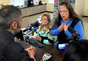 Rowan County Clerk Kim Davis, right, talks with David Moore following her office's refusal to issue marriage licenses at the Rowan County Courthouse in Morehead, Ky., Tuesday, Sept. 1, 2015. Although her appeal to the U.S. Supreme Court was denied, Davis still refuses to issue marriage licenses. Timothy D. Easley/AP
