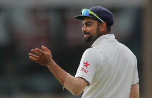 India's captain Virat Kohli gestures on the fourth day of the third test cricket match between India and Sri Lanka in Colombo, Sri Lanka, Monday, Aug. 31, 2015.