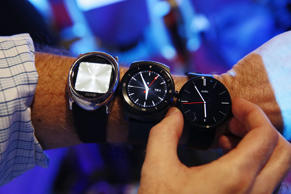 (From left) Smartwatches made by Burg, LG & Motorola at the Consumer Electronics Show in Las Vegas, January 6, 2015.