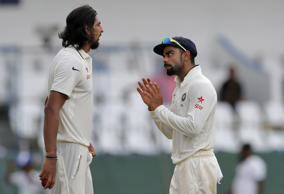 India's captain Virat Kohli, right, speaks to teammate Ishant Sharma on the third day of their third test cricket match against Sri Lanka in Colombo, Sri Lanka, Sunday, Aug. 30, 2015.