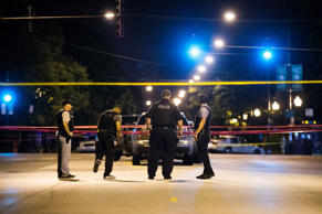 Members of the Chicago Police Department work the scene of a police-involved sho...