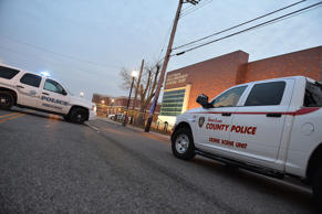 A St. Louis County Police Crime Scene Unit vehicle is parked near another police vehicle outside the Ferguson Police Department on March12, 2015 in Ferguson, MO