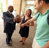 Prentice Women's Hospital and Maternity Center doorman Brian Wilson, left, sings Happy Birthday to expectant mother Meghan Landers and her baby bump as husband Alex Landers adds support on Aug. 31, 2015 in Chicago. Landers was arriving to deliver her baby. Wilson has been greeting expectant moms for 17 years. Phil Velasquez/Chicago Tribune/TNS