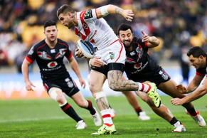 Josh Dugan of the St George Illawarra Dragons is tackled by Ben Matulino of the Warriors.