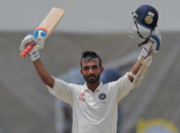 India's Ajinkya Rahane celebrates scoring a hundred during the fourth day's play of the second test cricket match between Sri Lanka and India in Colombo, Sri Lanka, Sunday, Aug. 23, 2015.
