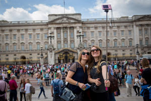 Tourists take a selfie in front of Buckingham Palace on in London, England.