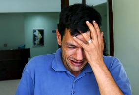 Abdullah Kurdi, father of three-year old Aylan Kurdi, cries as he leaves a morgu...