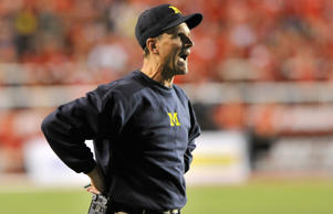 Head coach Jim Harbaugh of the Michigan Wolverines yells to his team late during their 24-17 loss to the Utah Utes at Rice-Eccles Stadium on Sept. 3 in Salt Lake City.