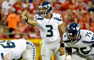 Quarterback Russell Wilson of the Seattle Seahawks calls out instructions at the line against the Kansas City Chiefs Aug. 21 in Kansas City, Mo.