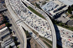 Vehicles sit in rush hour traffic at the interchange between the Interstate 405 and 10 freeways in this aerial photograph taken over Los Angeles.