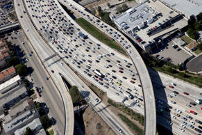 Vehicles sit in rush hour traffic at the interchange between the Interstate 405 ...