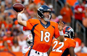 Denver Broncos quarterback Peyton Manning throws a pass against the San Francisco 49ers during the first half of an NFL preseason football game on Aug. 29, 2015, in Denver.