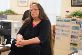 Kim Davis, the Rowan County Clerk of Courts, listens to Robbie Blankenship and Jesse Cruz as they speak with her at the County Clerks Office on September 2, 2015 in Morehead, Kentucky.