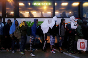People walk in a long line out of Budapest, Hungary, Friday, Sept. 4, 2015. Over...