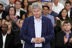 Conservative leader and Canada's PM Harper pauses during a campaign event in Ottawa