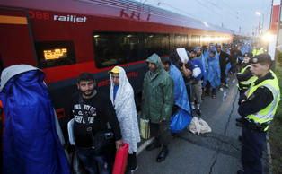 Migrants arrive at the Austrian train station of Nickelsdorf to board trains to ...