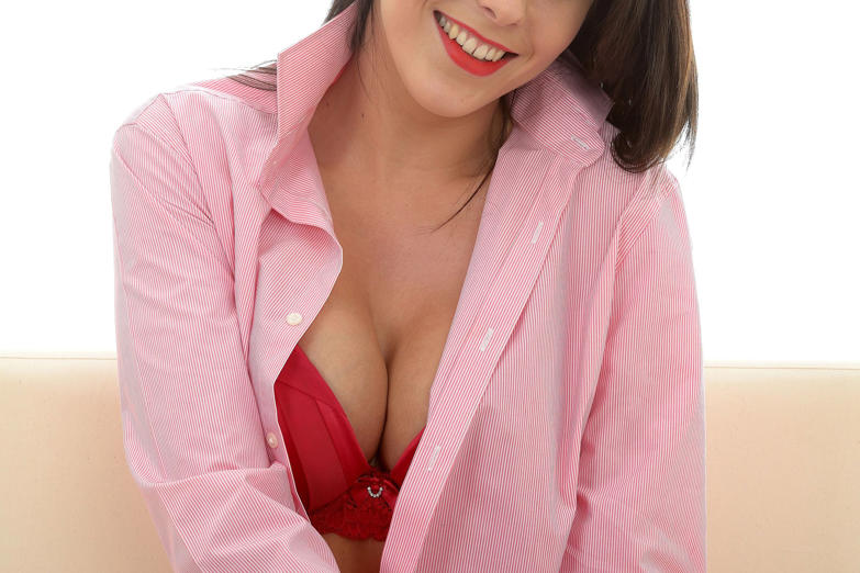 Woman wearing a pink open shirt. Martin Lee/REX
