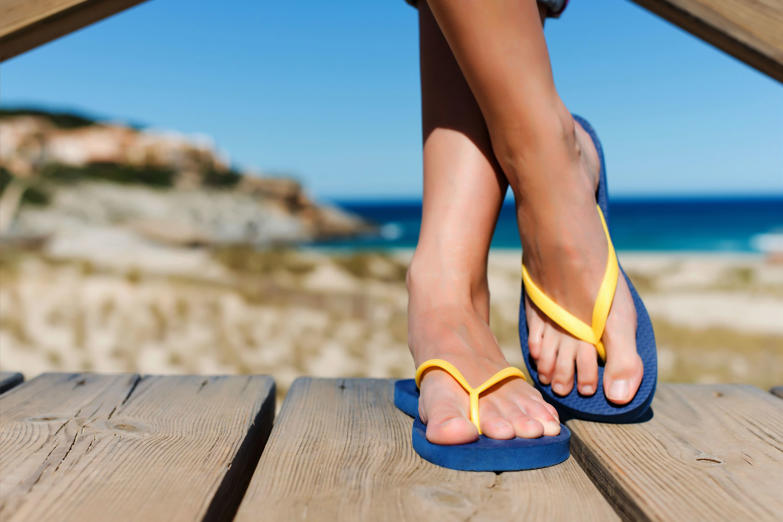 Woman wearing slippers. iStock/Getty Images