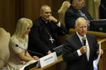 California Gov. Jerry Brown, right, delivers his speech in the Synod Hall as he attends a conference on Modern Slavery and Climate Change at the Vatican, Tuesday, July 21, 2015. Dozens of environmentally friendly mayors from around the world are meeting at the Vatican this week to bask in the star power of eco-Pope Francis and commit to reducing global warming and helping the urban poor deal with its effects.