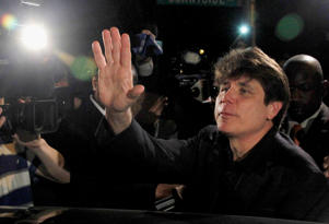 FILE - In this March 15, 2012 file photo, former Illinois Gov. Rod Blagojevich waves as he departs his Chicago home for Littleton, Colo., to begin his 14-year prison sentence on corruption charges. The 7th U.S. Circuit Court of Appeals in Chicago on Tuesday, July 21, 2015, tossed out some of Blagojevich's convictions that he sought to sell or trade President Barack Obama's old U.S. Senate seat.