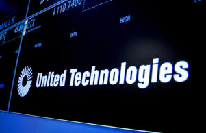 The ticker symbol for United Technologies is displayed on a screen on the floor of the New York Stock Exchange July 20, 2015. Lockheed Martin Corp said Monday it would buy Sikorsky Aircraft, the helicopter unit of United Technologies Corp, for $9 billion, and would review the possible sale or spinoff of $6 billion in other information technology and services businesses. REUTERS/Brendan McDermid