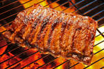 Grilled pork ribs. Somsak Sudthangtum/iStockphoto/Getty Images