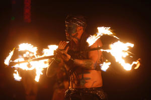 "Members of the Kenna Tribe fire conclave perform during the Burning Man 2014 ""Caravansary"" arts and music festival in the Black Rock Desert of Nevada."