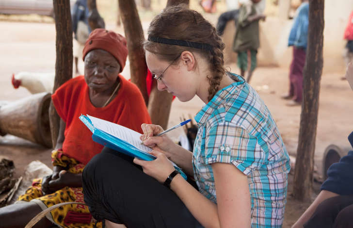 Young woman taking notes while volunteering.