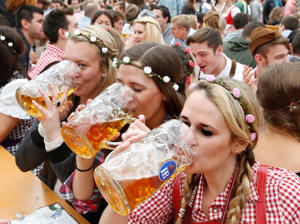 Visitors enjoy beer during the Oktoberfest in Munich.