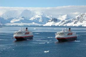 "In this picture issued by the Norwegian shipping company OVDS, Norwegian costal express liners MS ""Nordnorge"" left, and MS ""Nordkapp"" right, cruise in Paradise Bay in the Antarctic, Saturday Dec. 5. 2005. It is the fourth season for the MS ""Nordnorge"" while for ""MS ""Nordkapp"" it is the first season. More than 3 600 passengers have experienced the exotic Antarctic cruise so far this year."