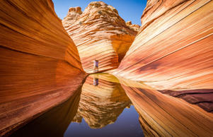 Visitors at The Wave rock formation in the Arizona Rocky Desert. Francesco Riccardo Iacomino/Getty Images