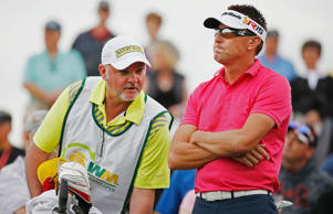 Robert Allenby of Australia waits on the 11th tee with his caddie during the first round of the Waste Management Phoenix Open at TPC Scottsdale on January 29, 2015 in Scottsdale, Arizona.
