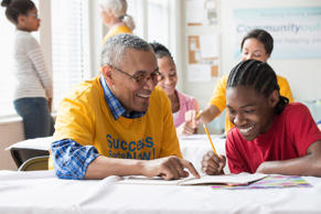 Volunteer tutoring students. Blend Images/Getty Images