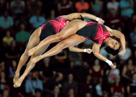 Annia Rivera and Yaima Mena of Cuba compete during the women's synchronized 10-meter platform diving event at the Pan Am Games in Toronto, Monday, July 13, 2015.