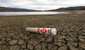 In this Feb. 4, 2014 file photo, a warning buoy sits on the dry, cracked bed of Lake Mendocino near Ukiah, Calif.