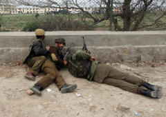 File: Indian paramilitary soldier take their positions during a gunfight in Srinagar March 13, 2013.
