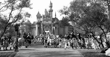 Children sprint across a drawbridge and into a castle that marks the entrance to Fantasyland at the opening of Walt Disney's Disneyland in Anaheim, Calif.