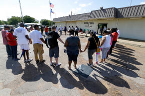 Protesters join hands outside the Waller County Jail in Hempstead, Texas, Friday July 17, 2015, to protest the death of Sandra Bland, who was found dead in the jail. Waller County District Attorney Elton Mathis said there were no cameras in Bland's jail cell to show if the Illinois woman hanged herself in the lockup as a medical examiner has ruled. Her relatives and supporters dispute the finding.