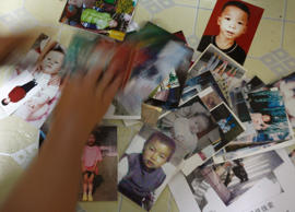 Photographs of some of the lost children in Dongguan area in China's southern Guangdong province.