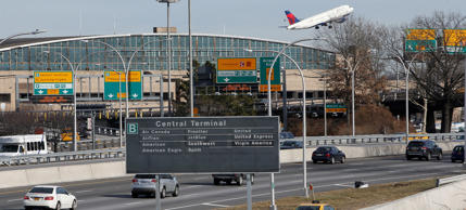 Cars on the Grand Central Parkway pass LaGuardia Airport in New York.