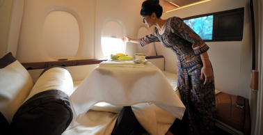 Singapore Airlines flight steward, Sharmala Huey Yuen, opens a window in the luxury suite class, of the new Singapore Airlines A380 superjumbo aircraft.