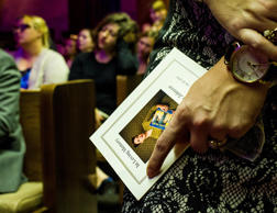 A funeral attendee holds a program during the funeral service for Jillian Johnson at Delhomme Funeral Home in Lafayette, La., Monday, July 27, 2015. Jillian Johnson was a victim of the The Grand 16 movie theater shooting in Lafayette on Thursday, July 23.